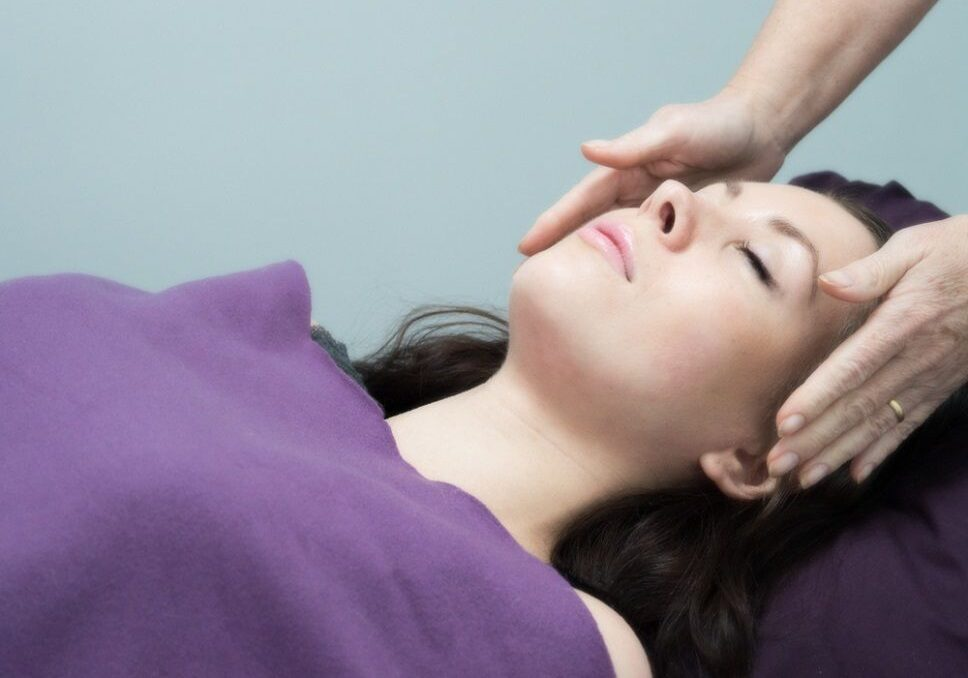 Picture Of Woman Having Reiki Treatment